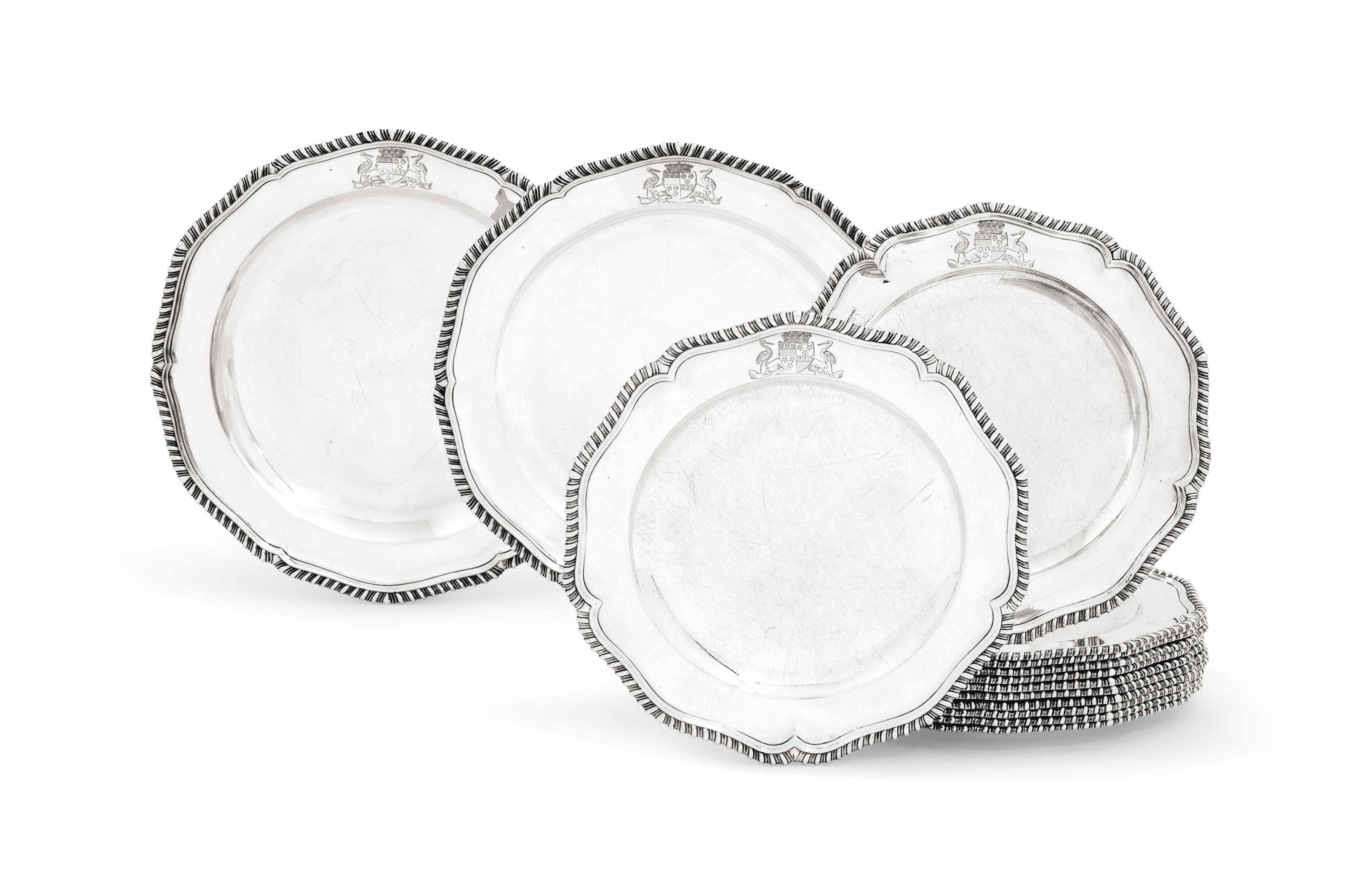 A SET OF TWELVE GEORGE III SILVER DINNER-PLATES AND A PAIR OF SECOND-COURSE DISHES EN SUITE