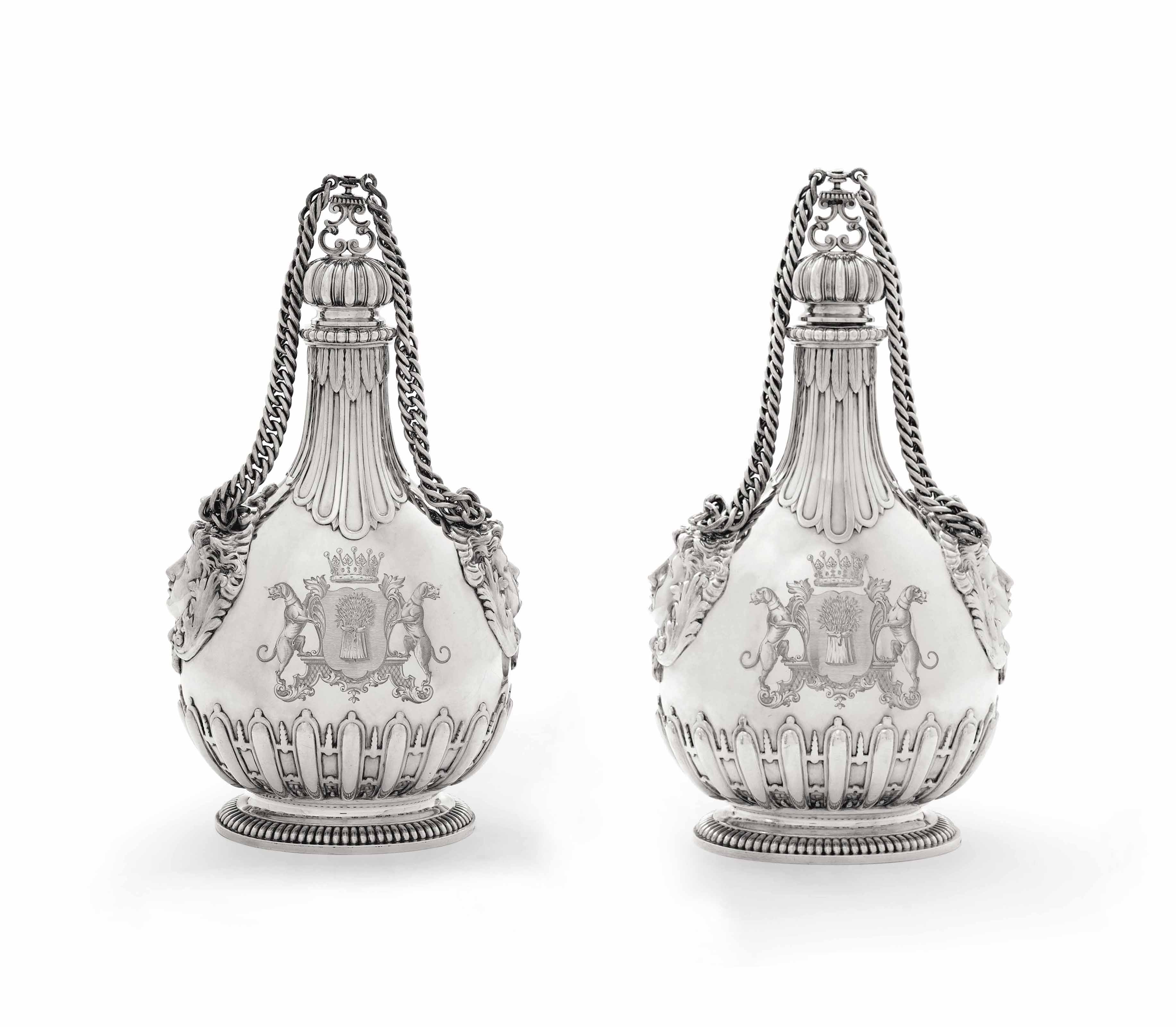 A PAIR OF VICTORIAN SILVER PILGRIM-FLASKS