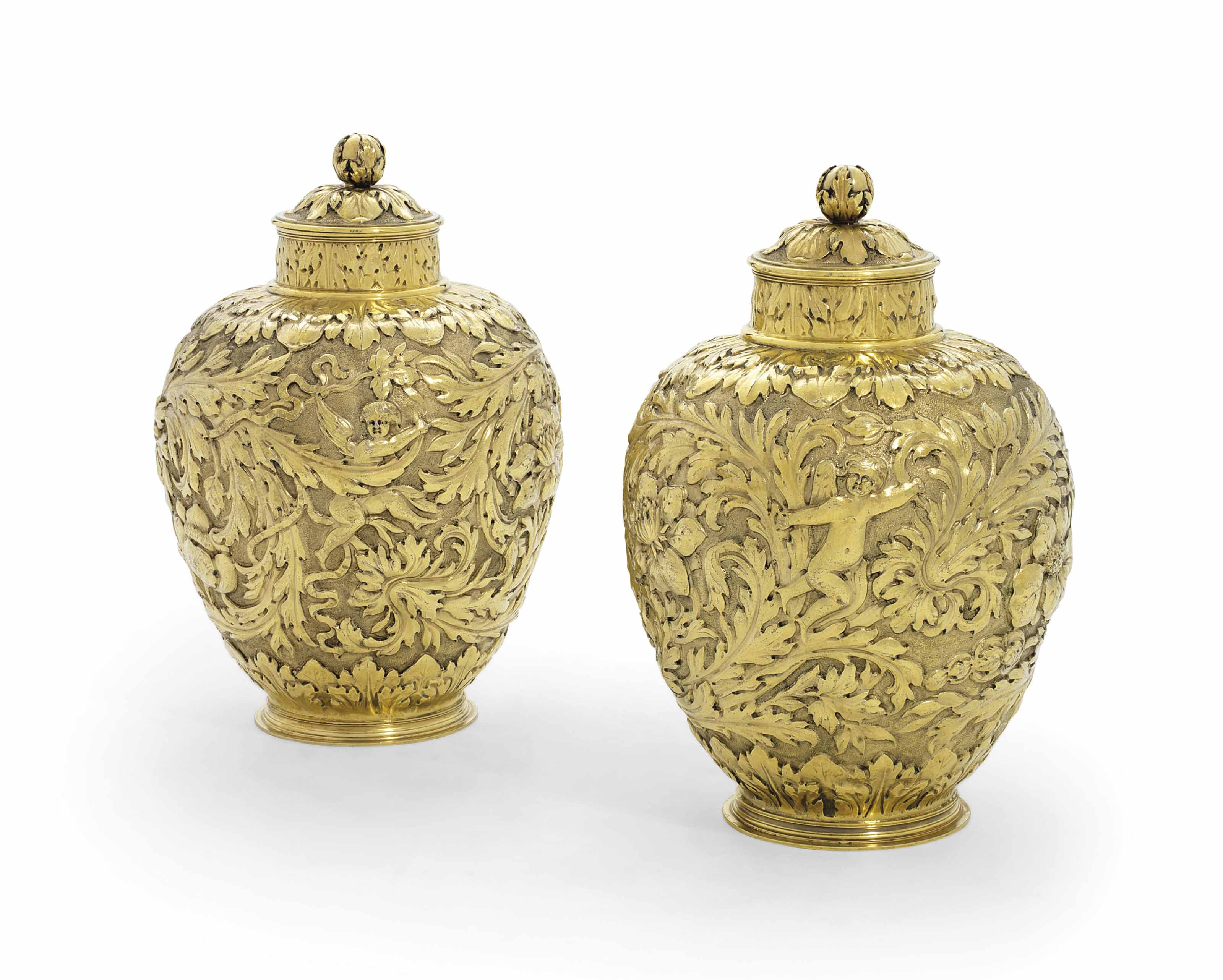 A PAIR OF GEORGE V SILVER-GILT FURNISHING-VASES