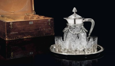 A SILVER-MOUNTED CUT-GLASS DRI