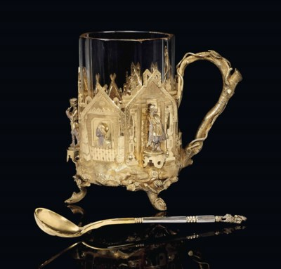 A PARCEL-GILT TEA GLASS HOLDER