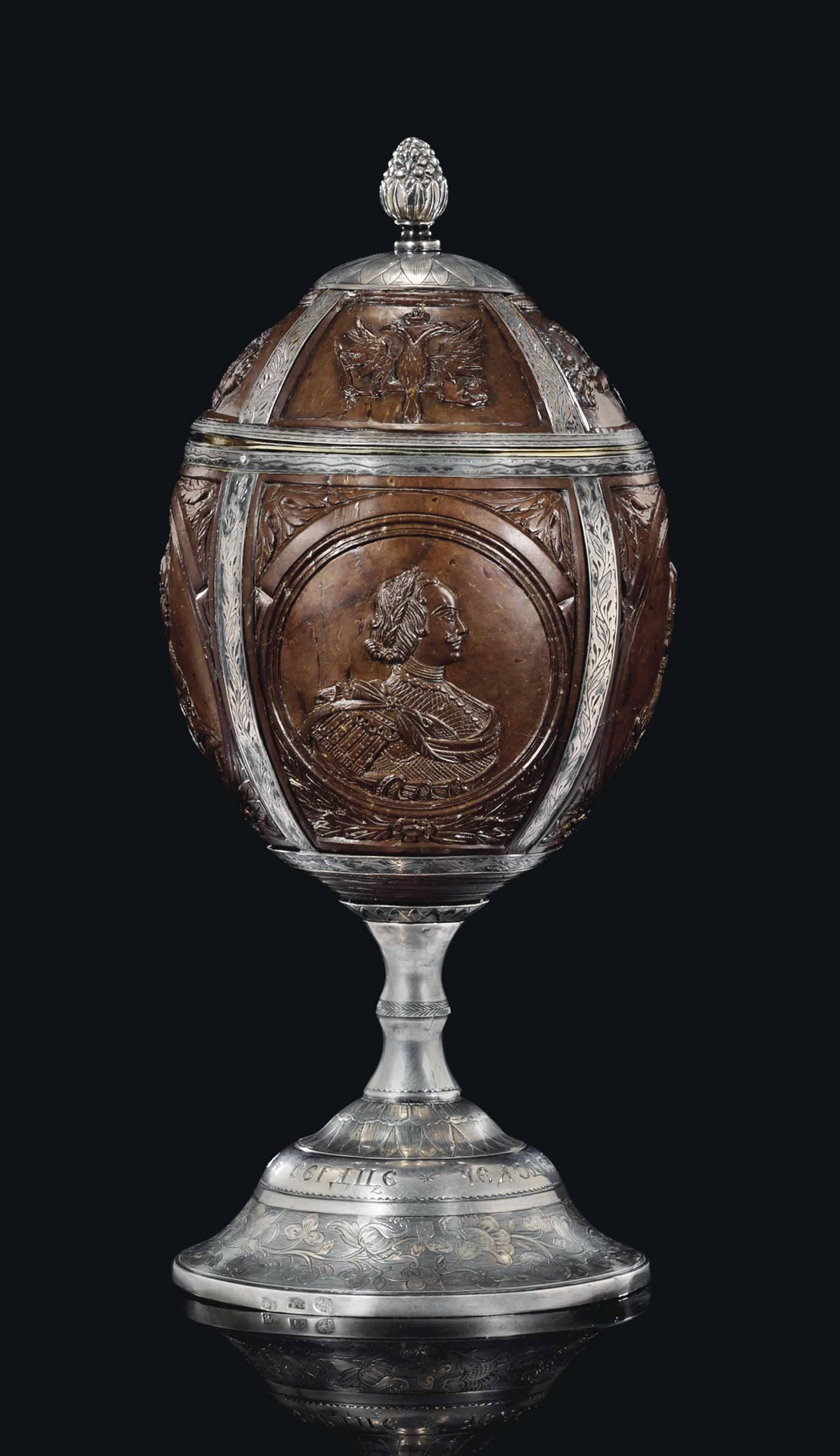 A SILVER-MOUNTED COCONUT CUP AND COVER
