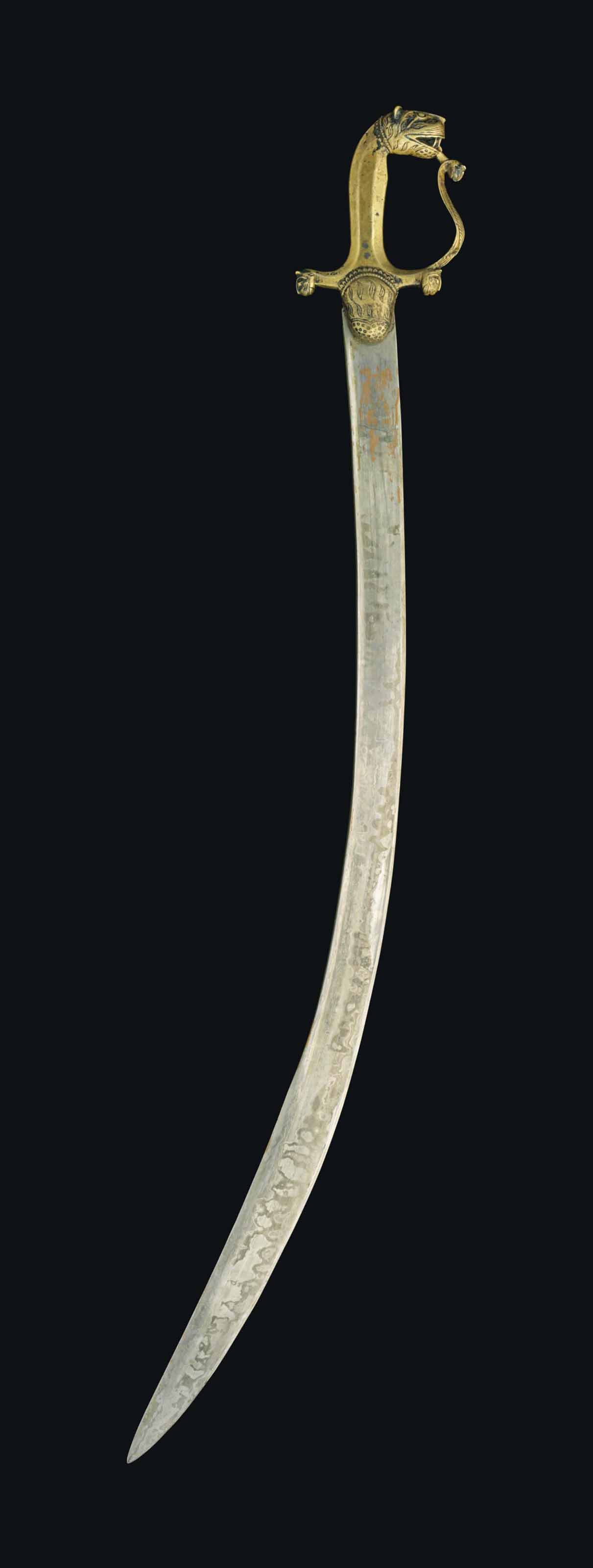 A SWORD WITH A TIGER-HEAD HILT