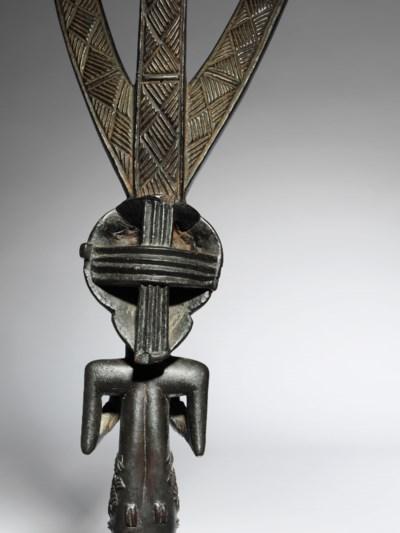 A Luba Female Figure for a Bow