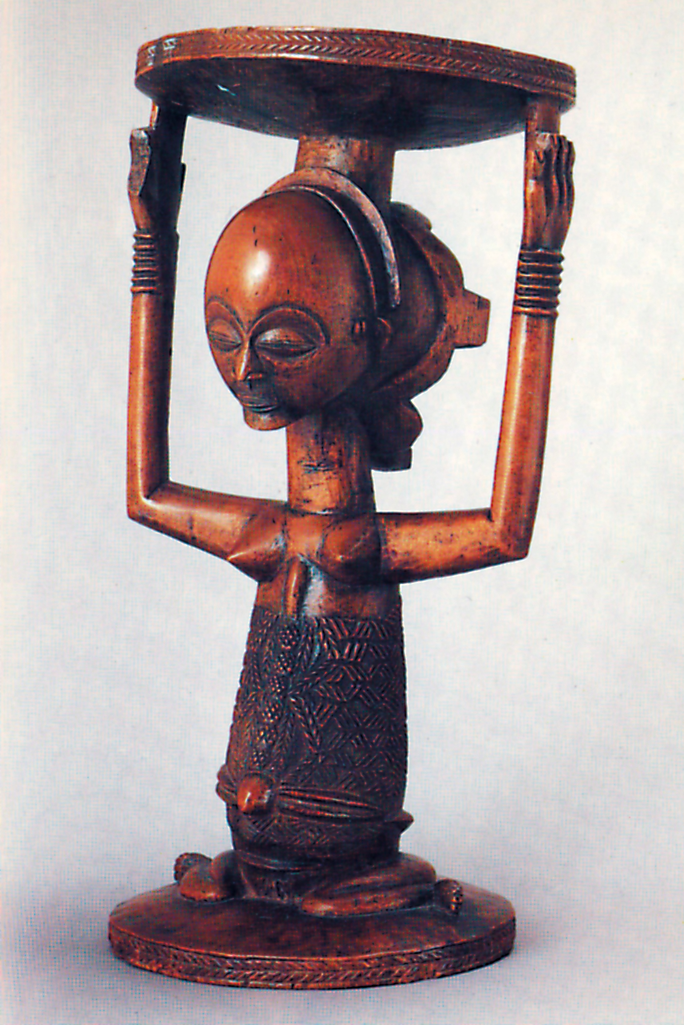 A Luba Female Figure for a Bow