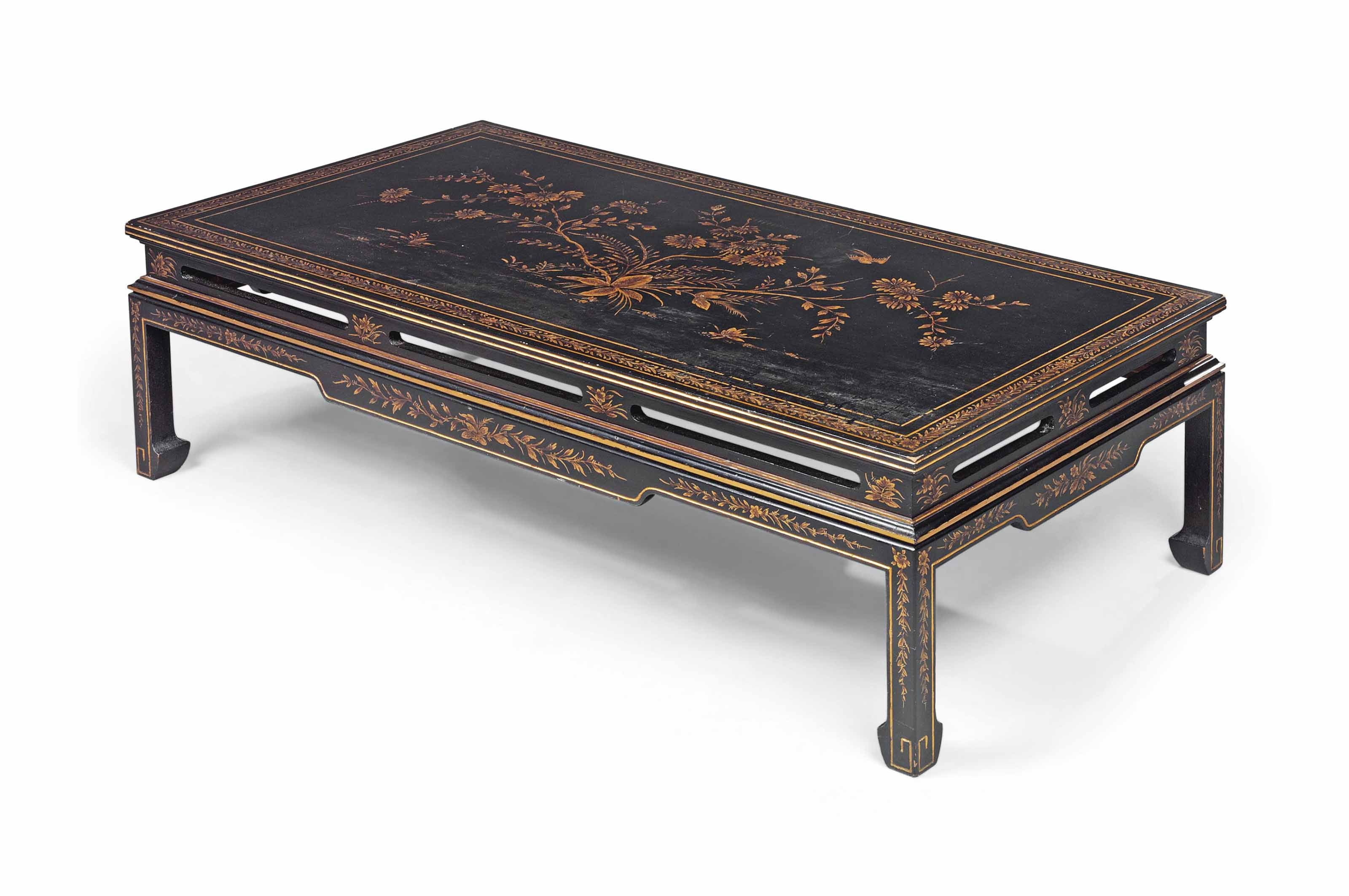 A BLACK AND GILT-JAPANNED LOW