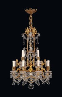 A FRENCH ORMOLU AND CUT-GLASS TWELVE-LIGHT CHANDELIER