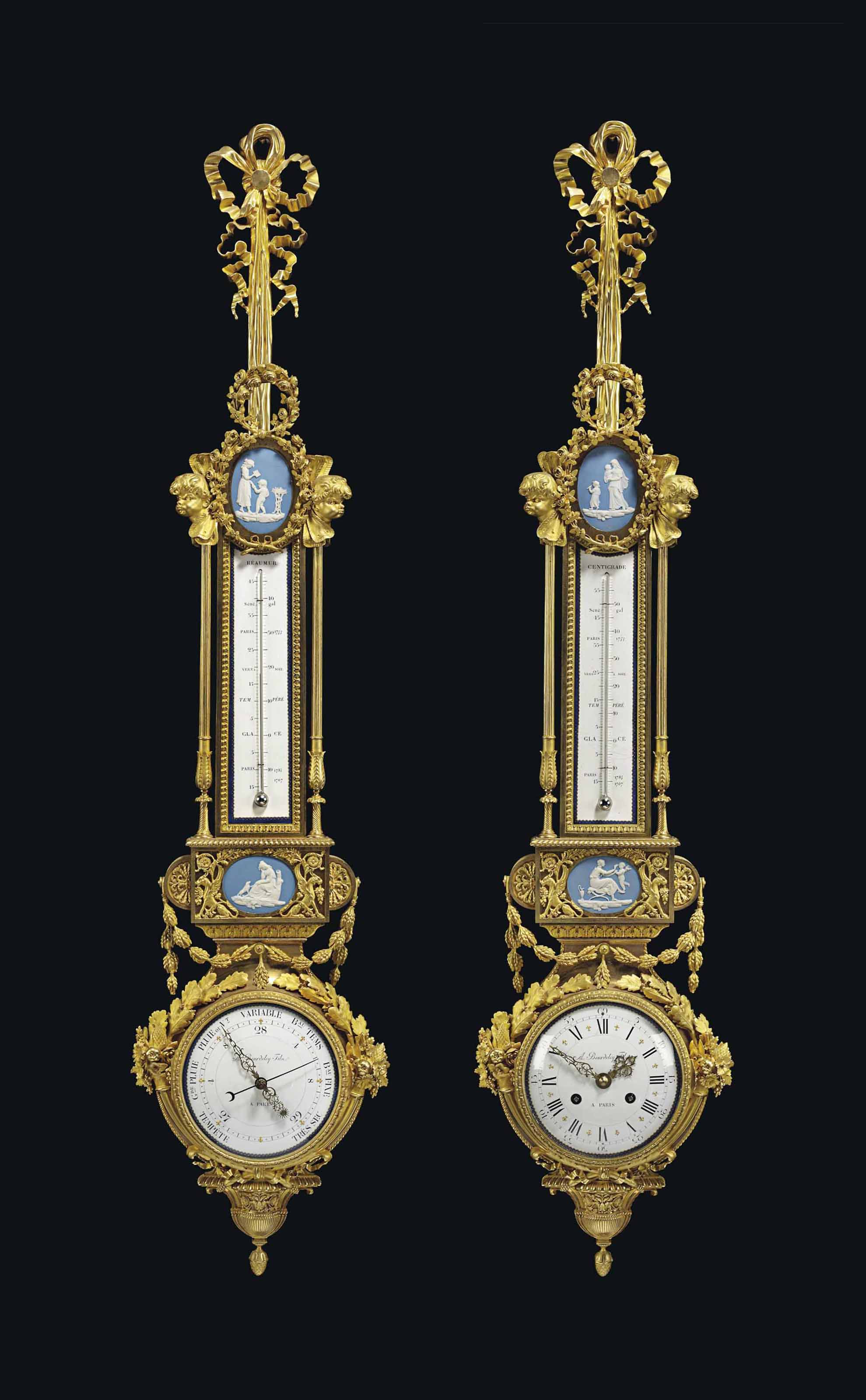 A FRENCH ORMOLU AND PORCELAIN CARTEL CLOCK AND BAROMETER