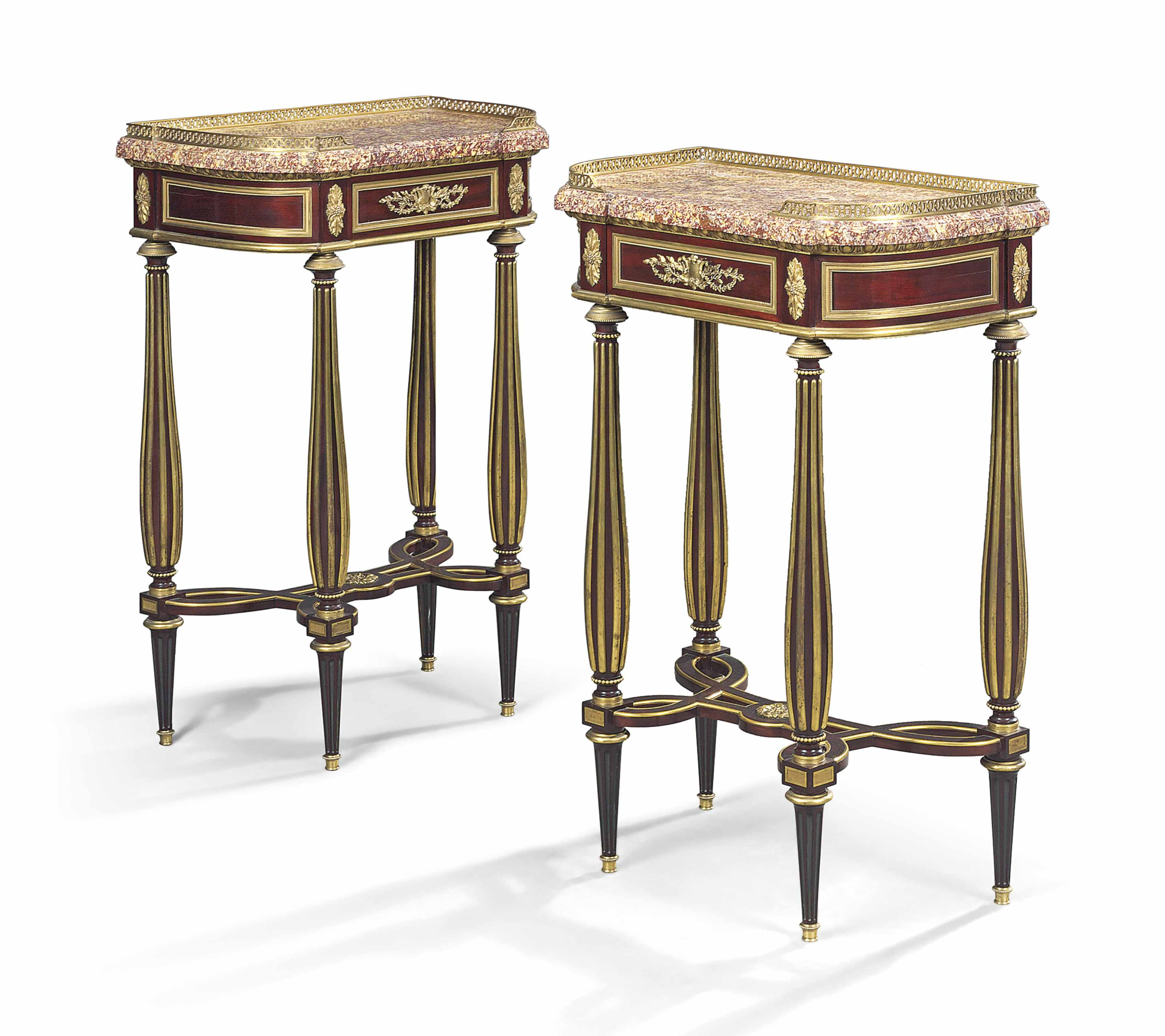 A PAIR OF FRENCH ORMOLU-MOUNTED MAHOGANY CONSOLE TABLES