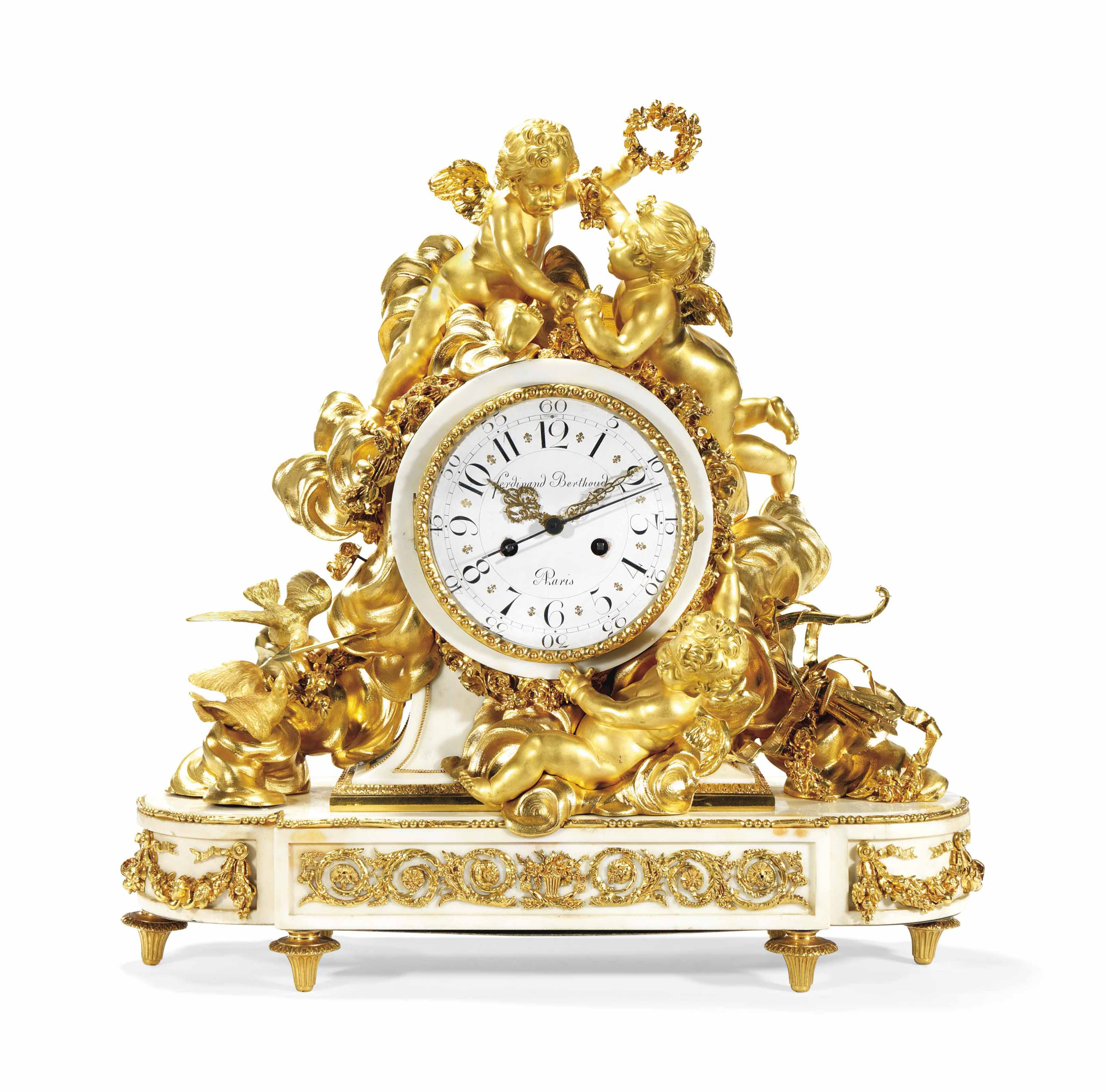A FRENCH ORMOLU AND MARBLE MANTEL CLOCK