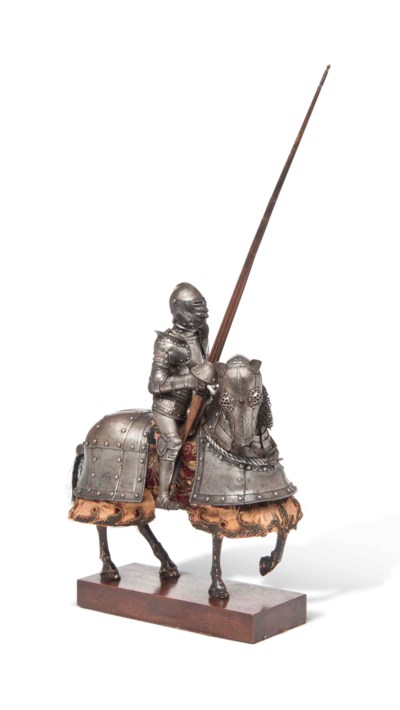 A MINIATURE ARMOUR FOR MAN AND