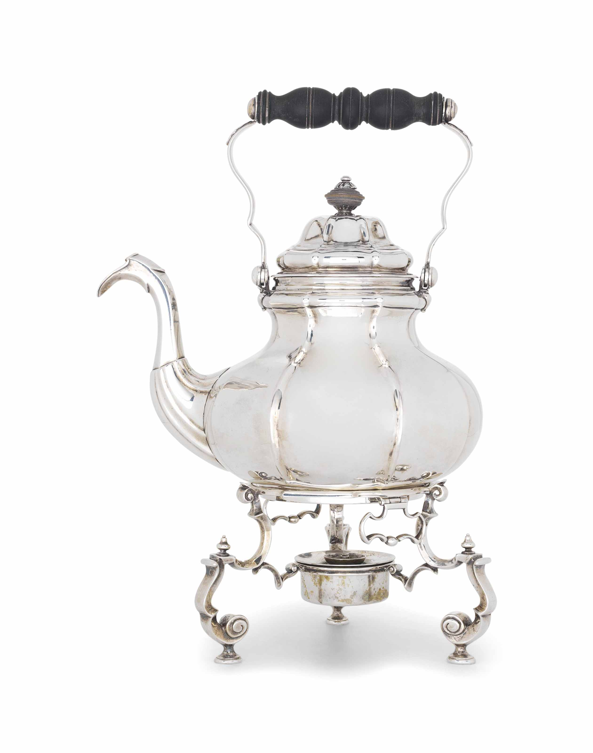 A GERMAN SILVER KETTLE AND STAND