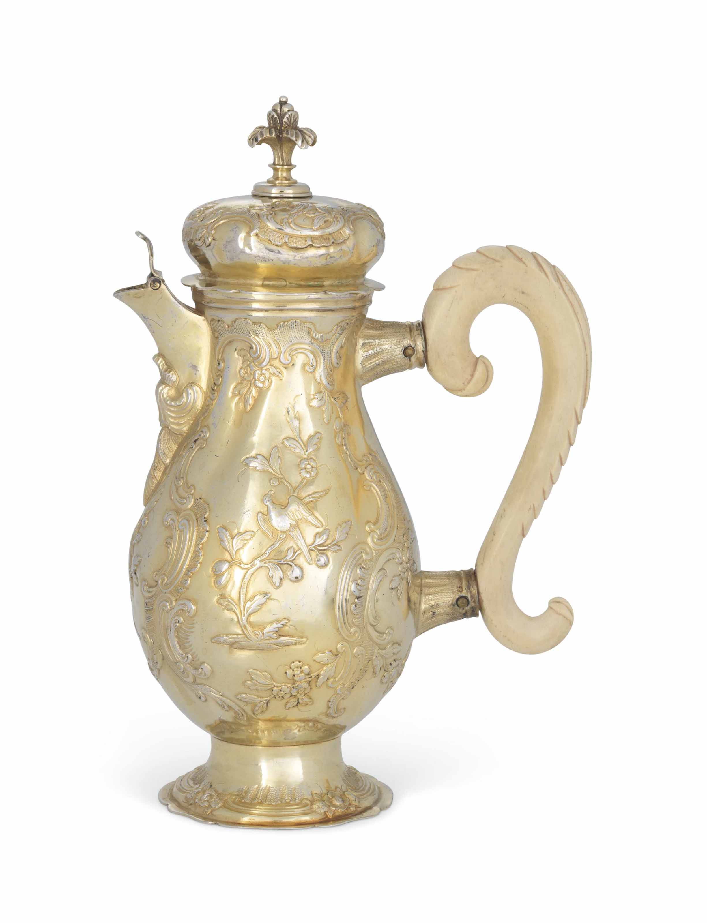 A GERMAN SILVER-GILT HOT-MILK JUG