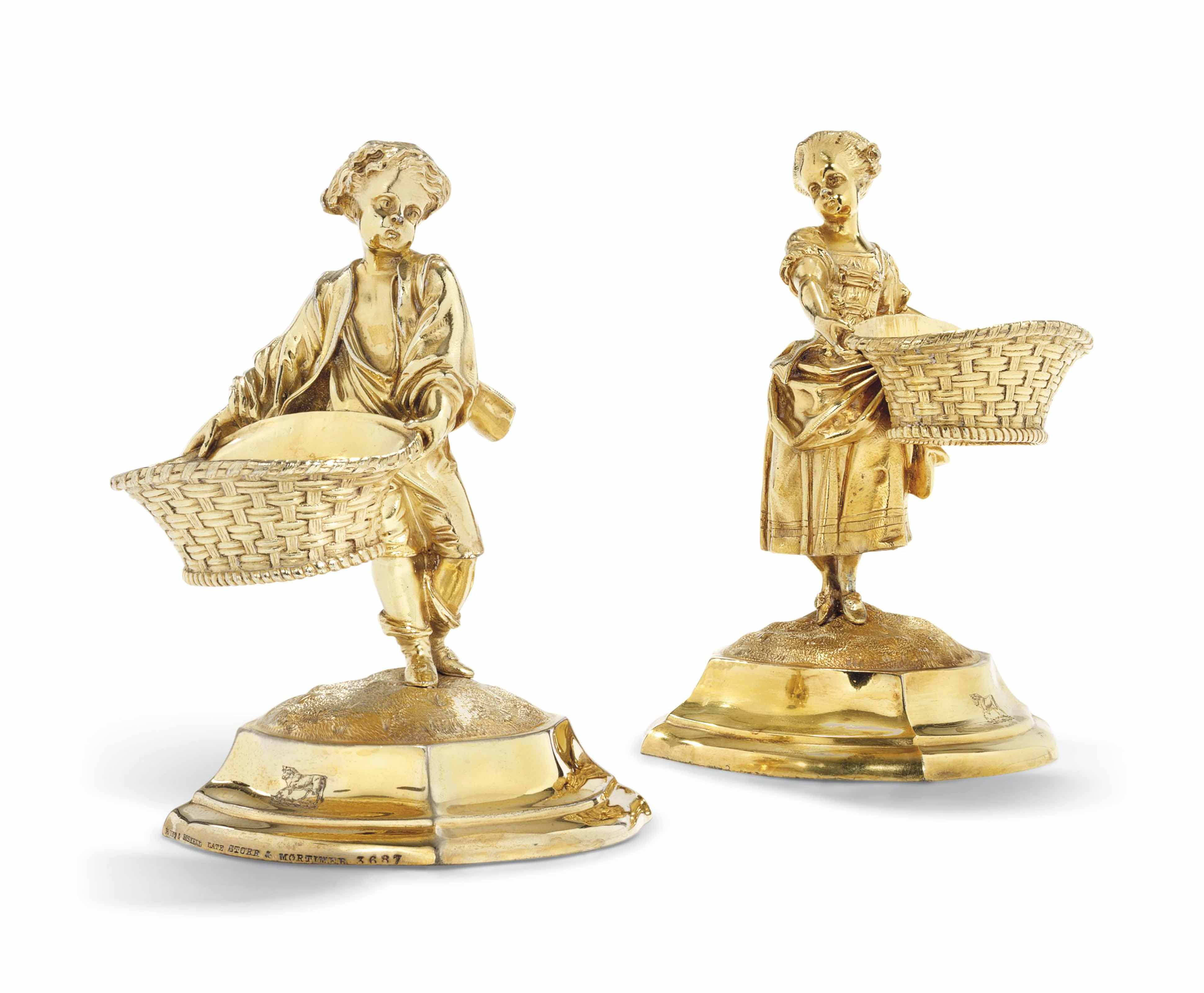 A PAIR OF VICTORIAN SILVER-GILT FIGURAL SALT-CELLARS