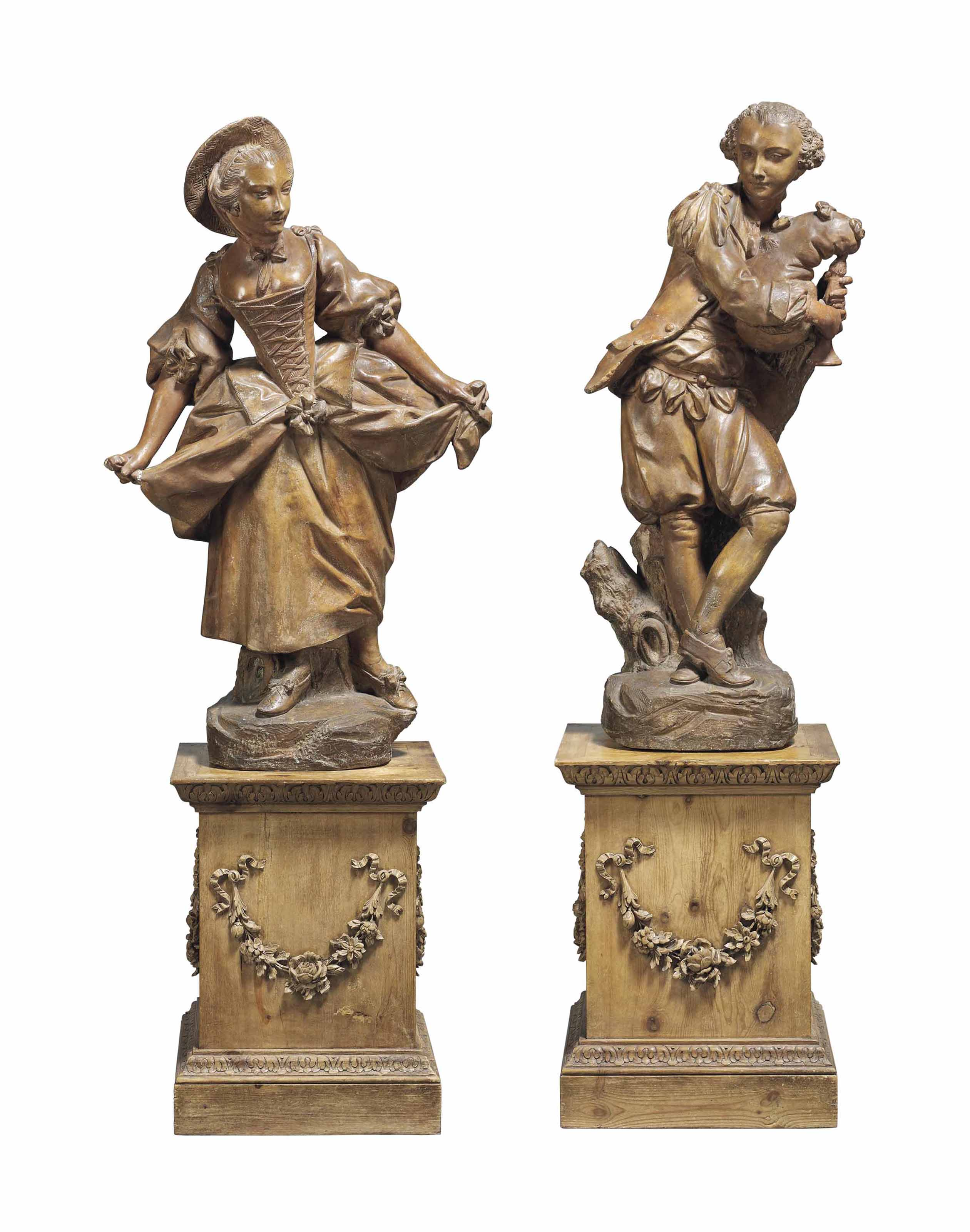 A PAIR OF FRENCH TERRACOTTA STANDING FIGURES