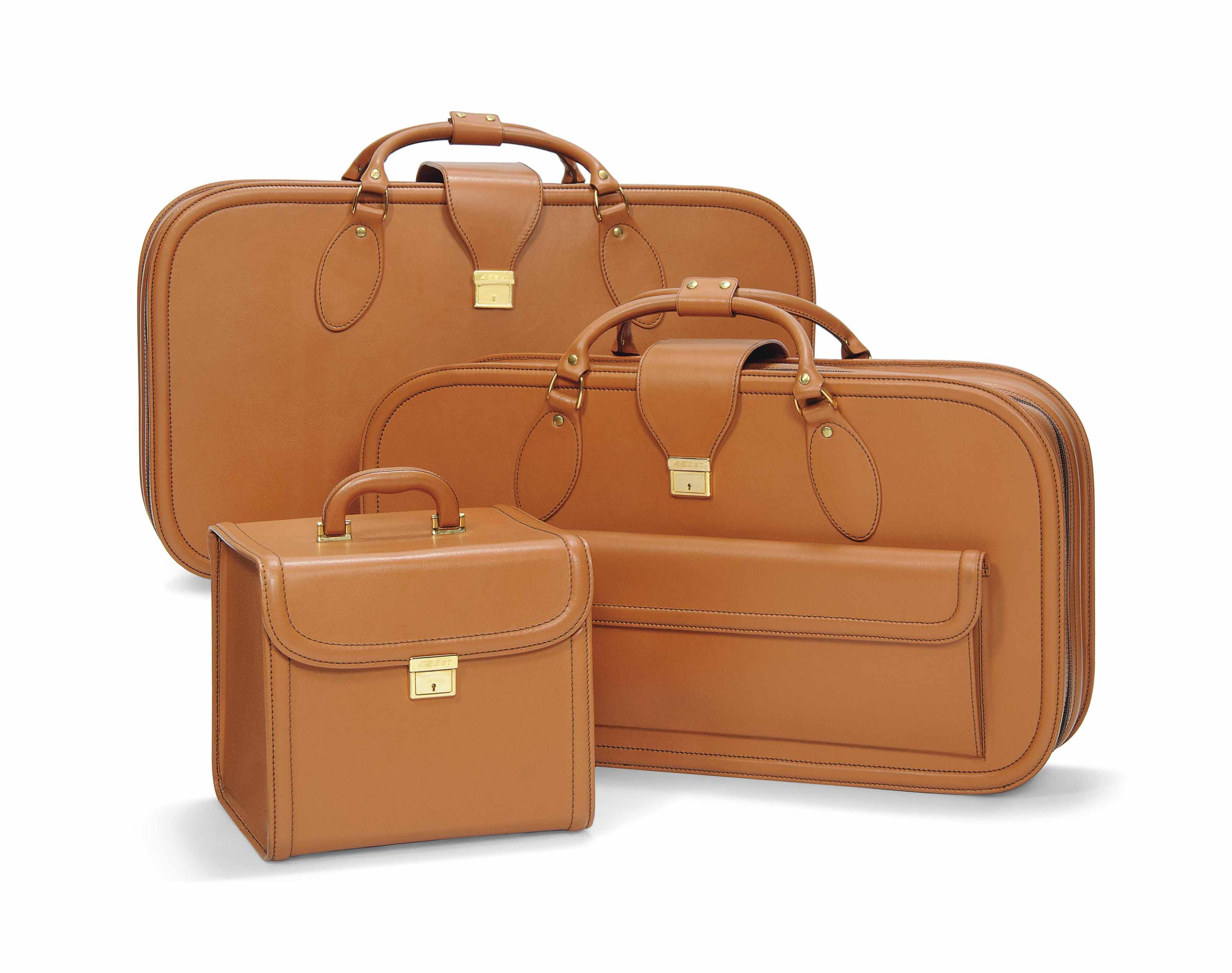 A Set Of Fitted Tan Leather Luggage For A Ferrari 456 Gt