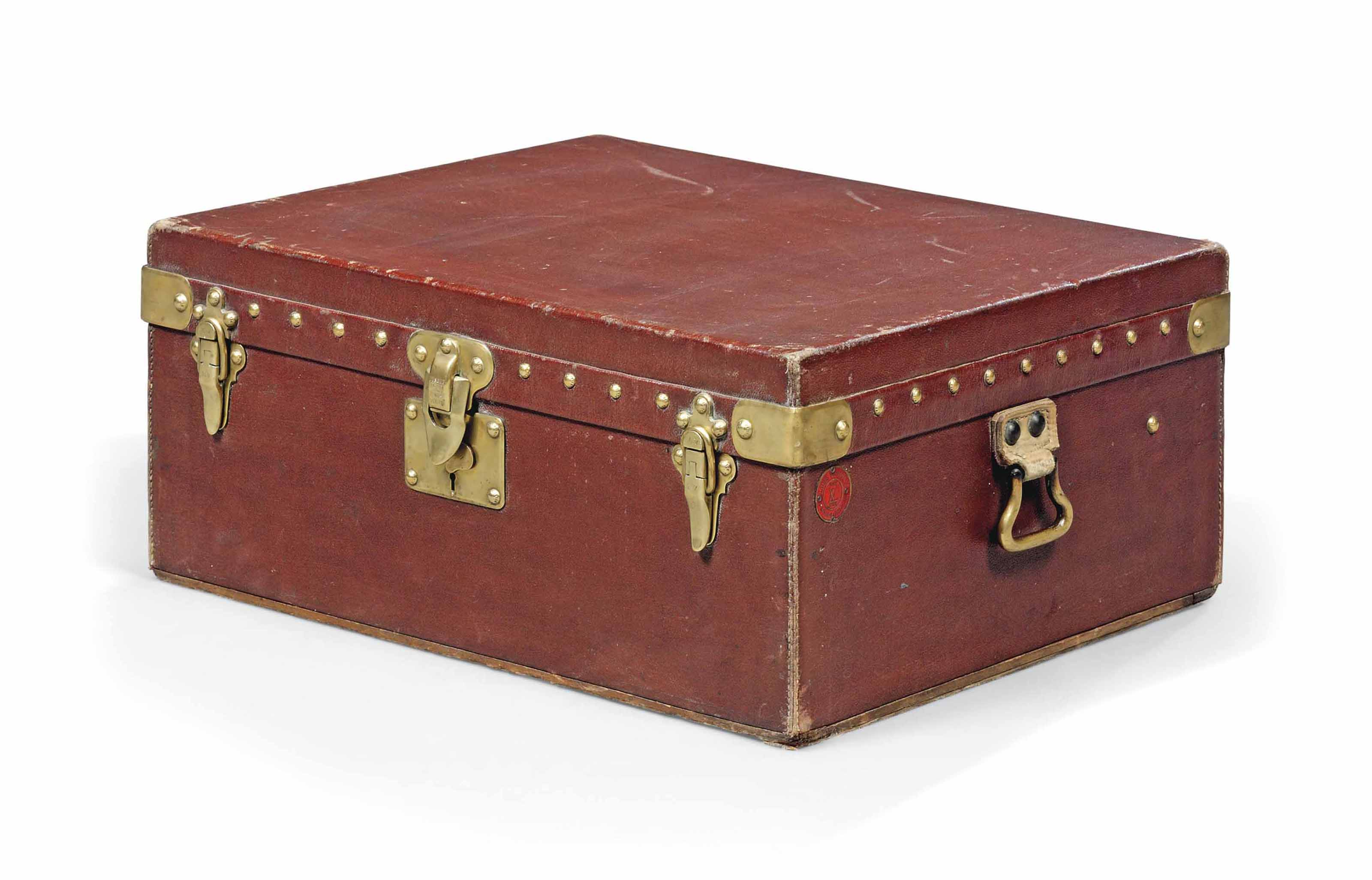 A MOTORING TRUNK IN BRICK RED