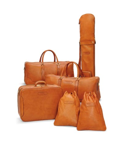 A SET OF TAN LEATHER LUGGAGE