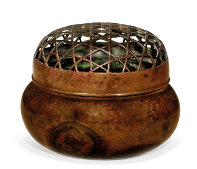 A BRONZE HAND WARMER AND COVER