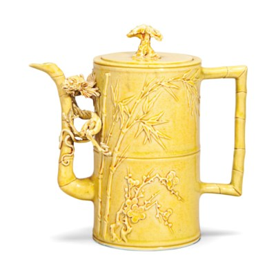 A YELLOW GLAZED CARVED EWER