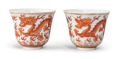A PAIR OF IRON RED 'DRAGON' CU