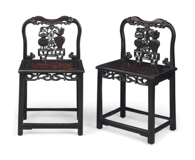 A PAIR OF BLACK WOOD CHAIRS