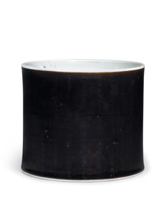 A MIRROR BLACK-GLAZED BRUSH PO