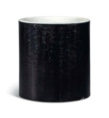 A SMALL MIRROR BLACK-GLAZED BR