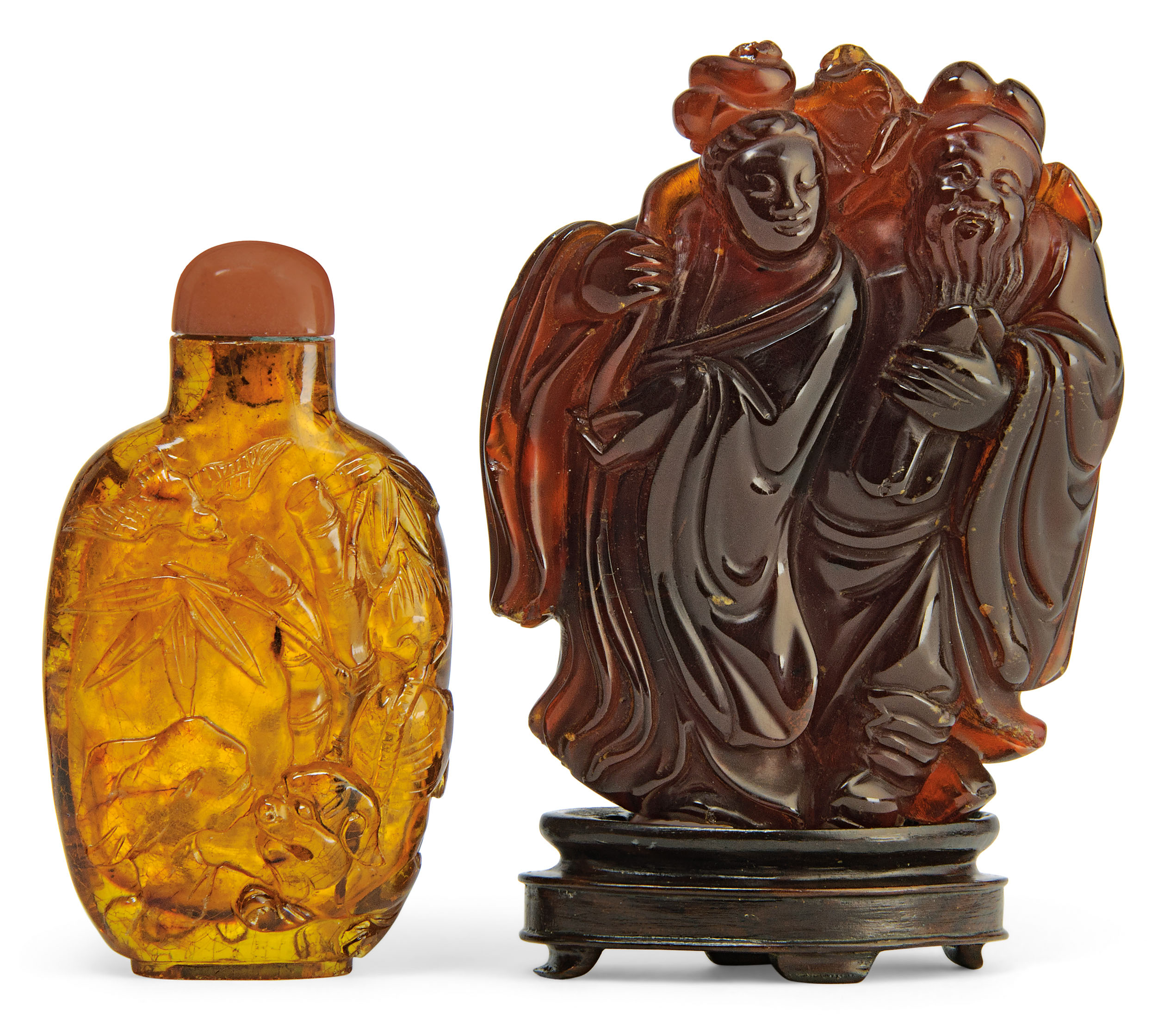 A CARVED AMBER 'IMMORTALS' GRO