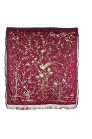 A BURGUNDY-GROUND COVERLET