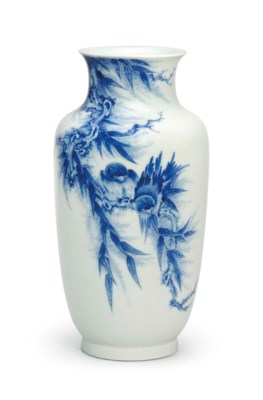 A BLUE AND WHITE LANTERN VASE