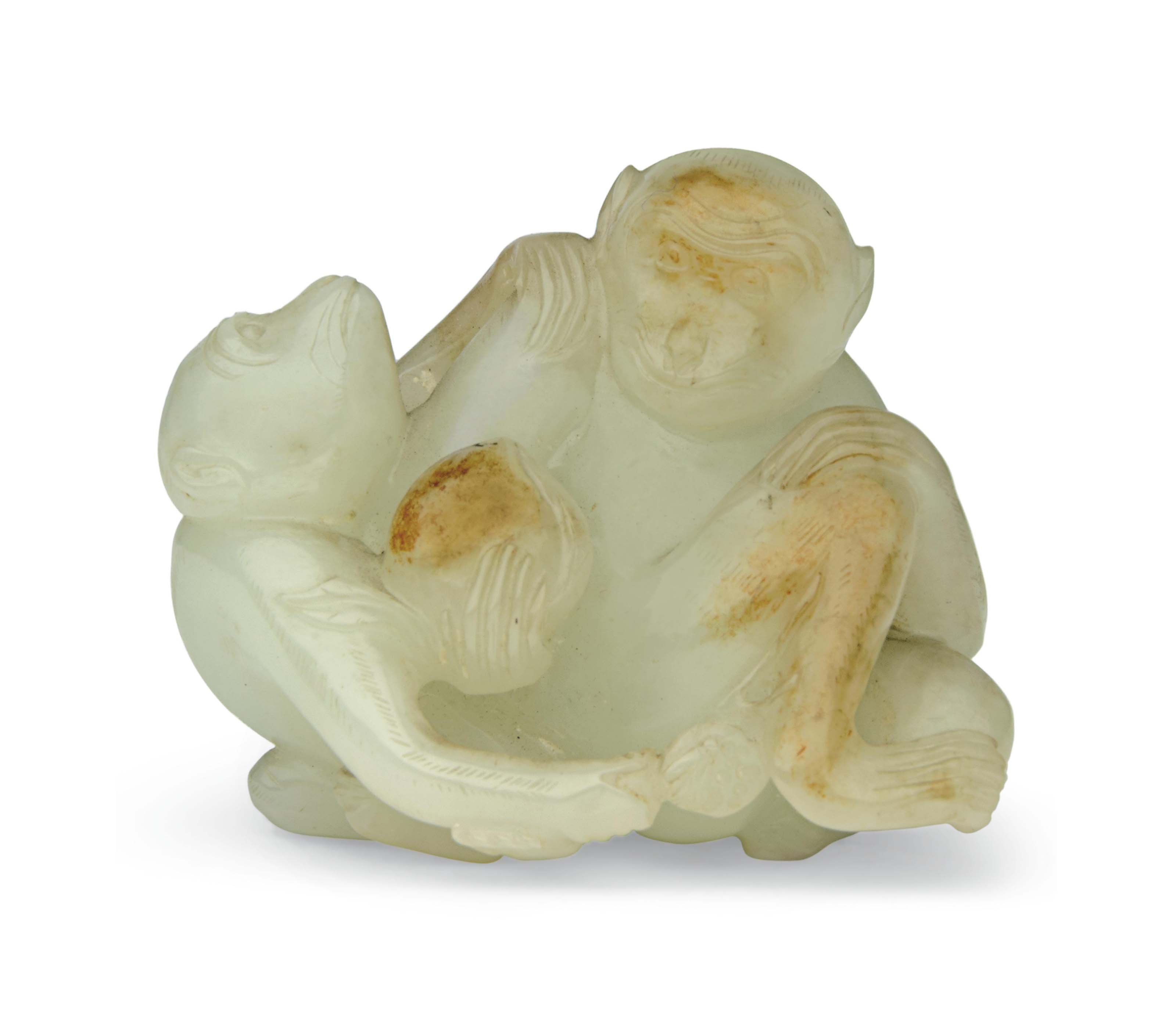 A PALE CELADON AND RUSSET JADE