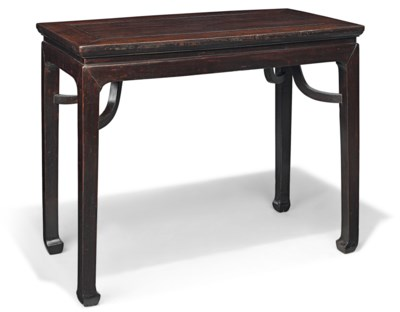 A HARDWOOD RECTANGULAR TABLE