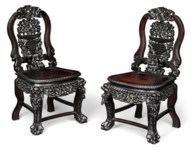 A PAIR OF HARDWOOD CARVED CHAI