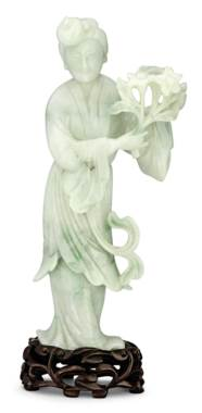 A GREENISH-WHITE JADEITE FIGUR