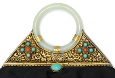 A WHITE JADE BANGLE WITH HARDS
