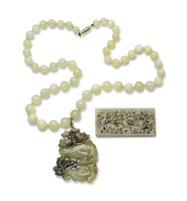 A CELADON AND GREY JADE 'BUTTE