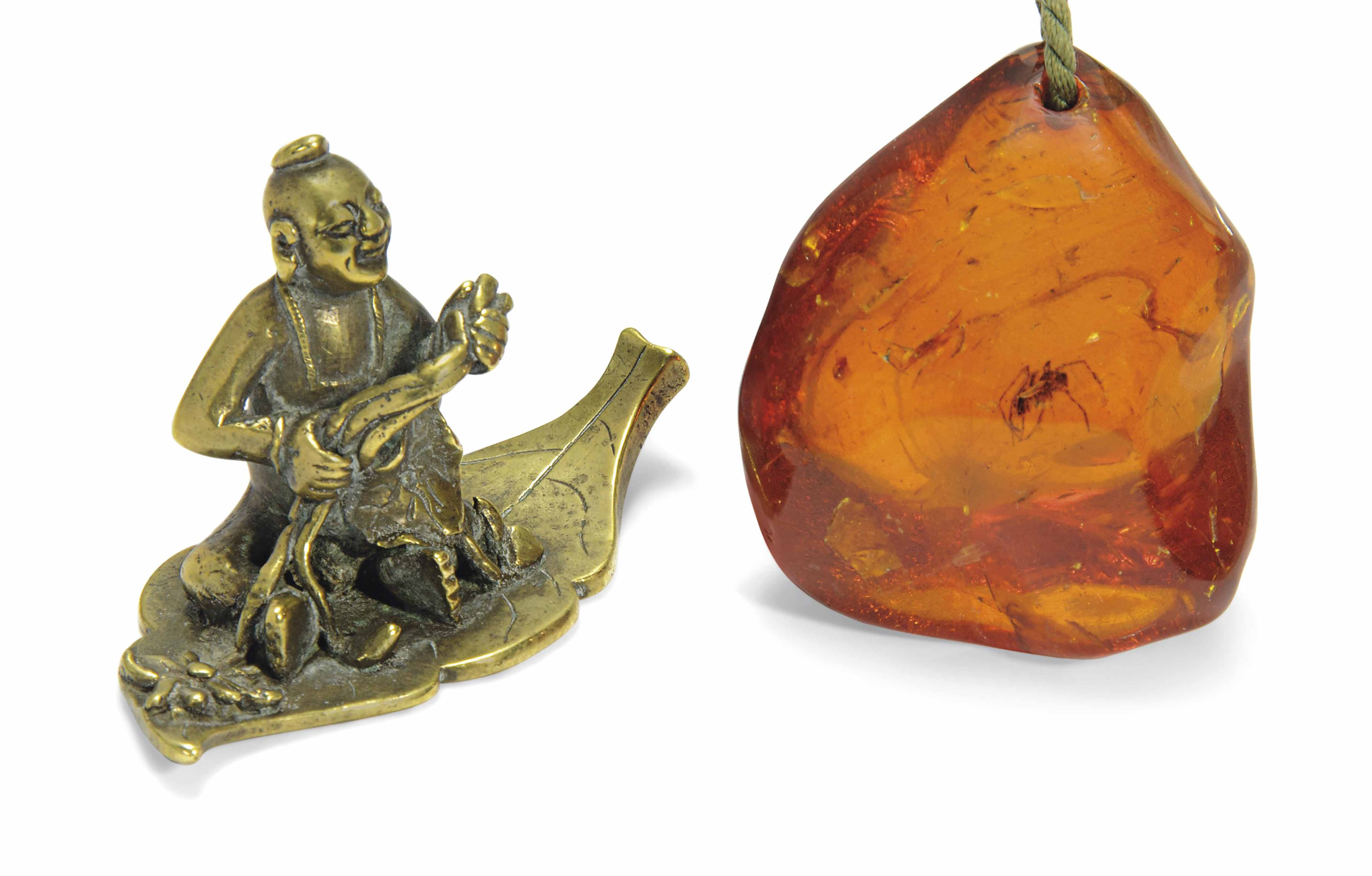 A BRONZE FIGURAL WEIGHT AND AN