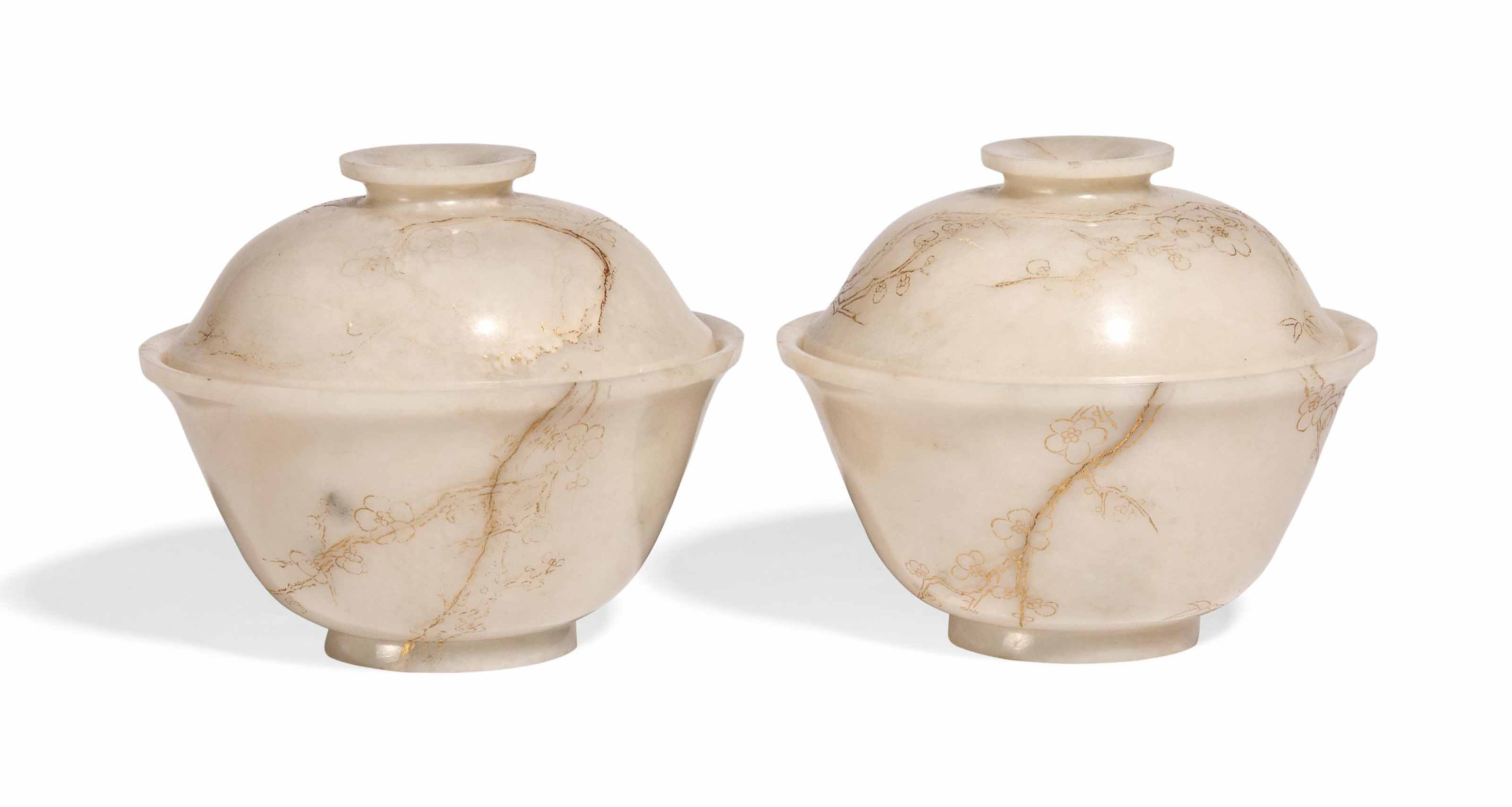 A PAIR OF WHITE JADE AND GILT-