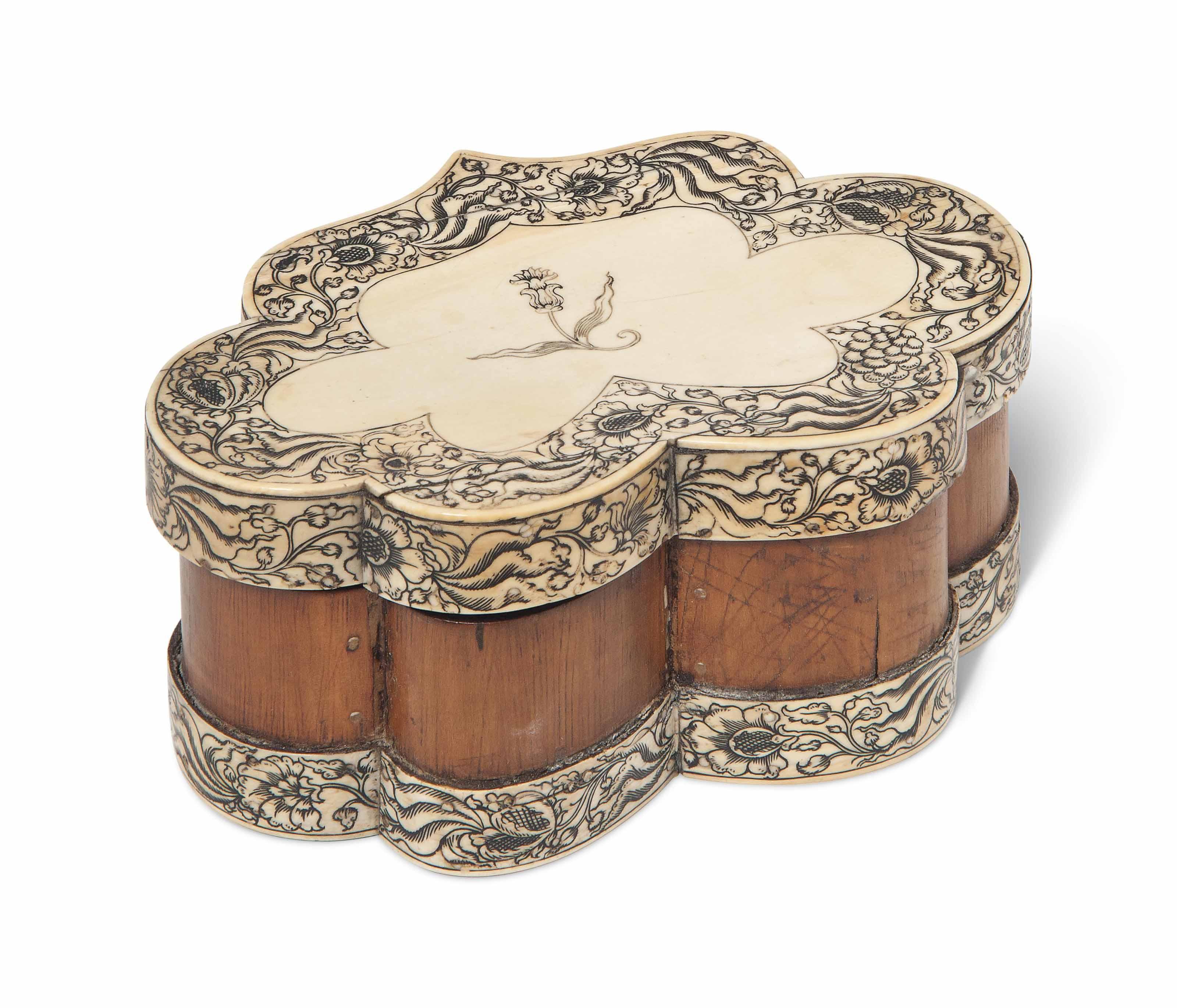 A VIZAGAPATAM IVORY-VENEERED SCALLOPED SANDALWOOD BOX