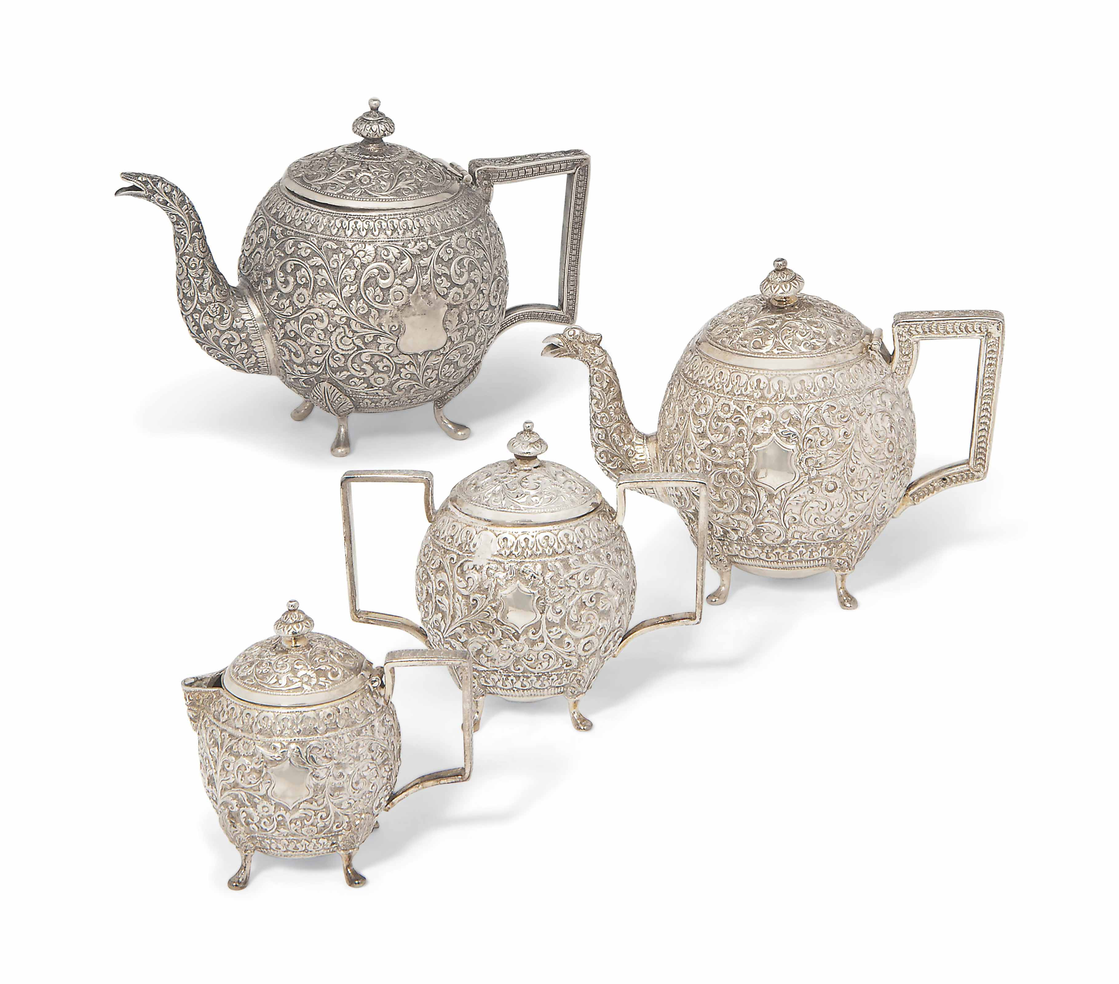 A SILVER REPOUSSÉ TEA SET