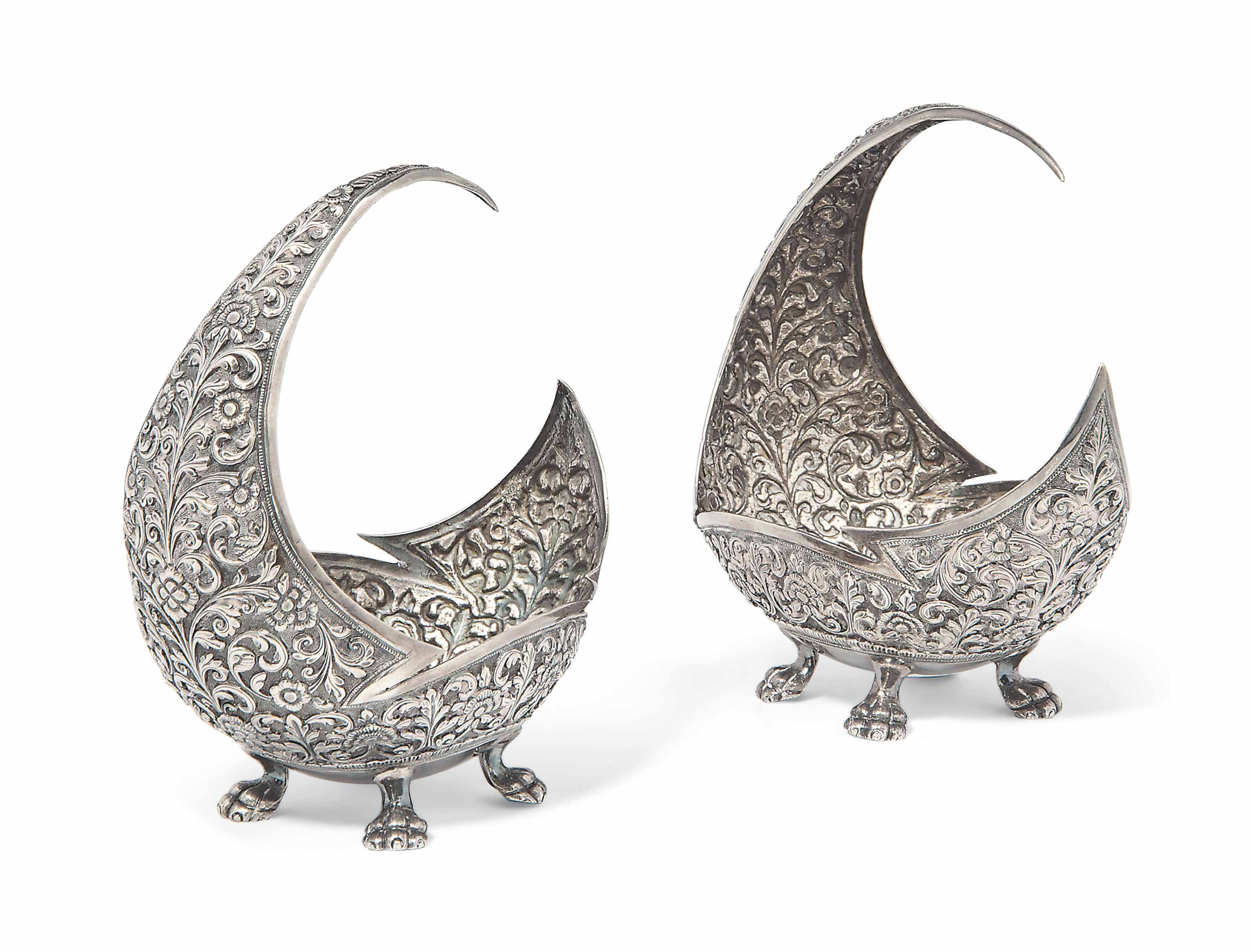 A PAIR OF SILVER REPOUSSÉ SWEE