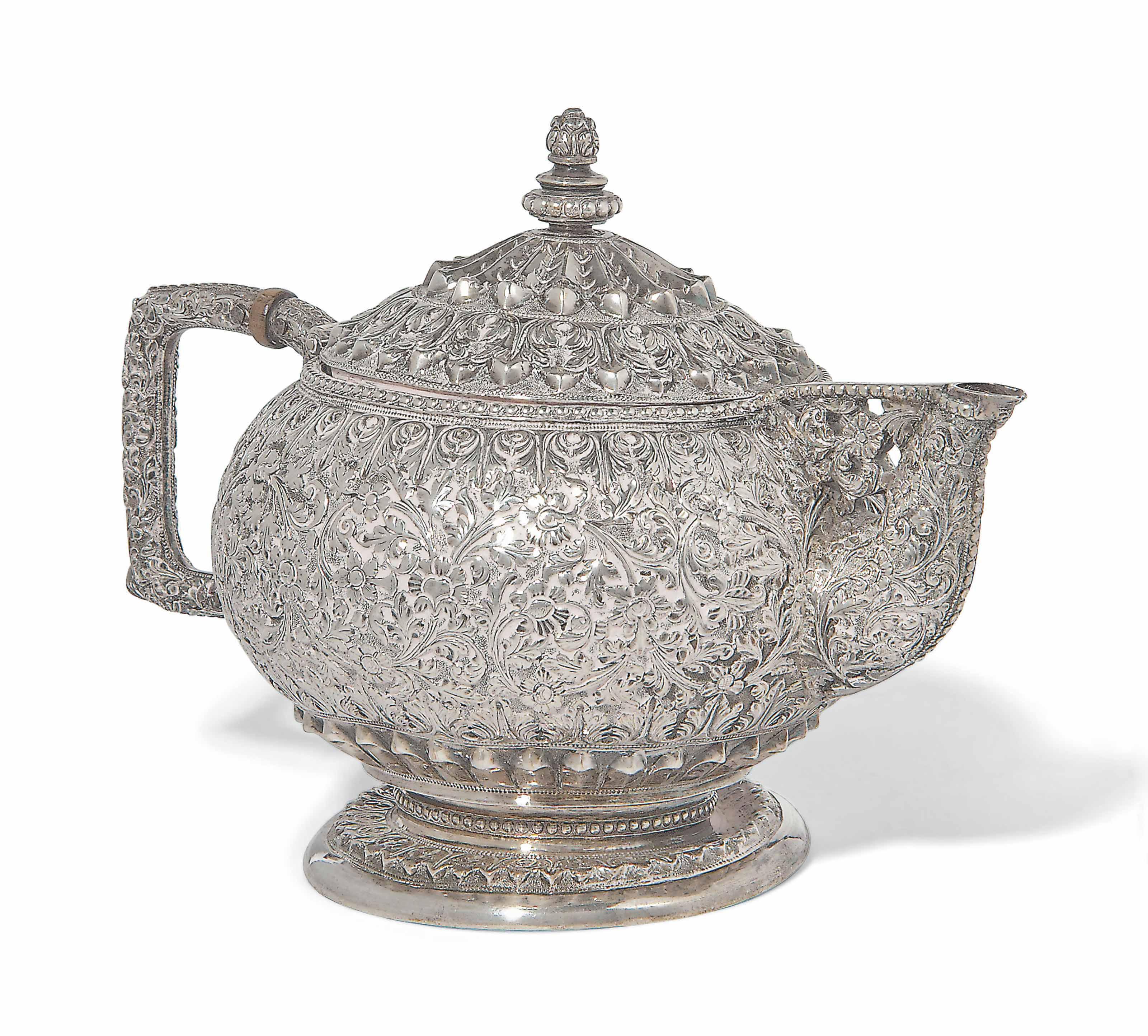 A SILVER REPOUSSÉ TEA POT