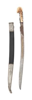 A FINE LARGE-EARED WALRUS-HILT