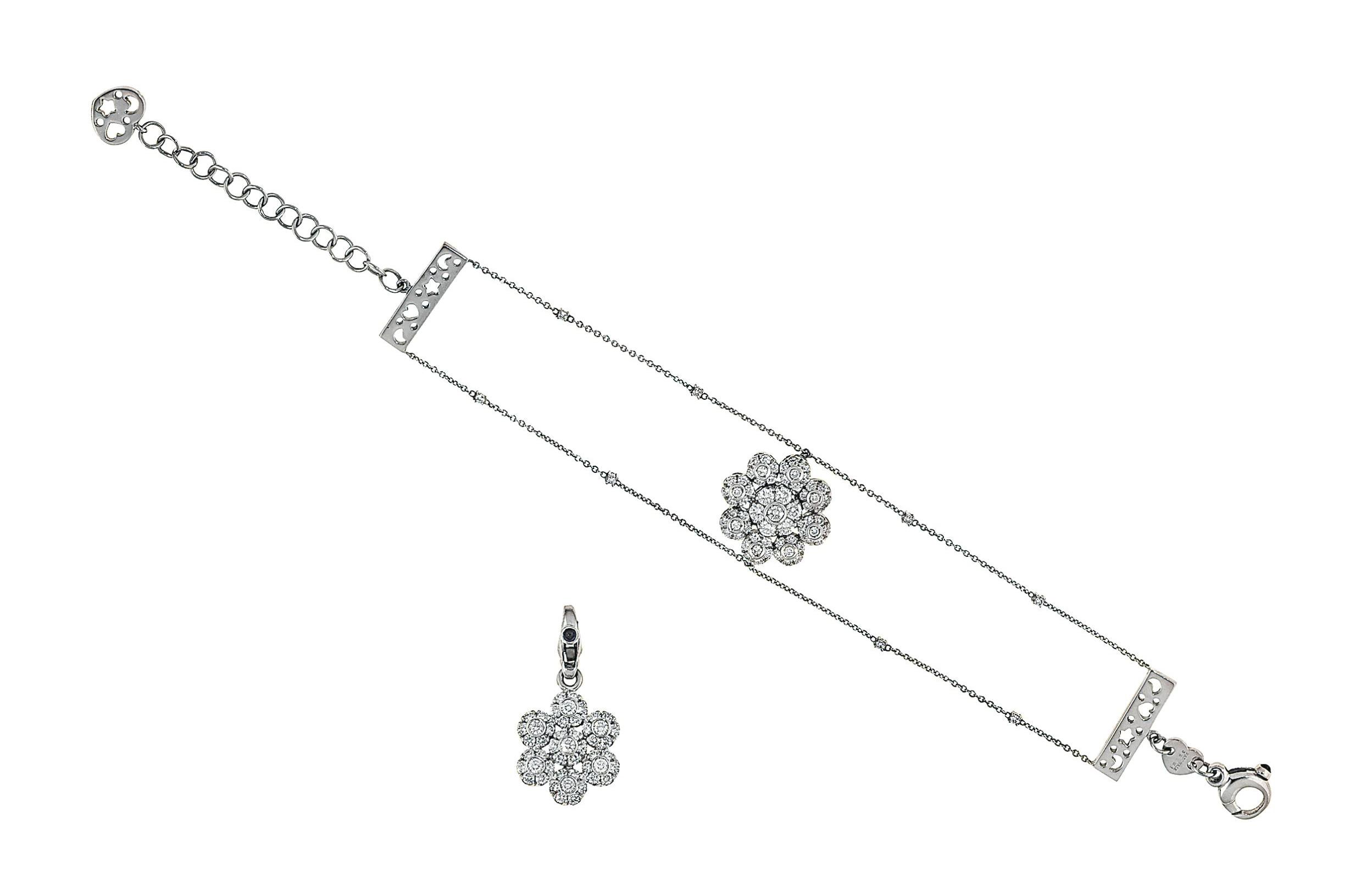 A diamond-set bracelet and pen