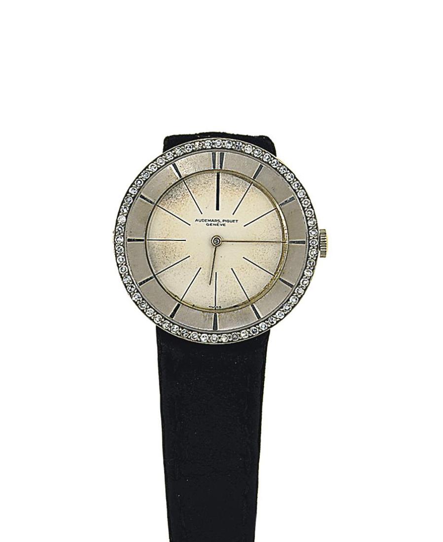 A diamond-set wristwatch, by A