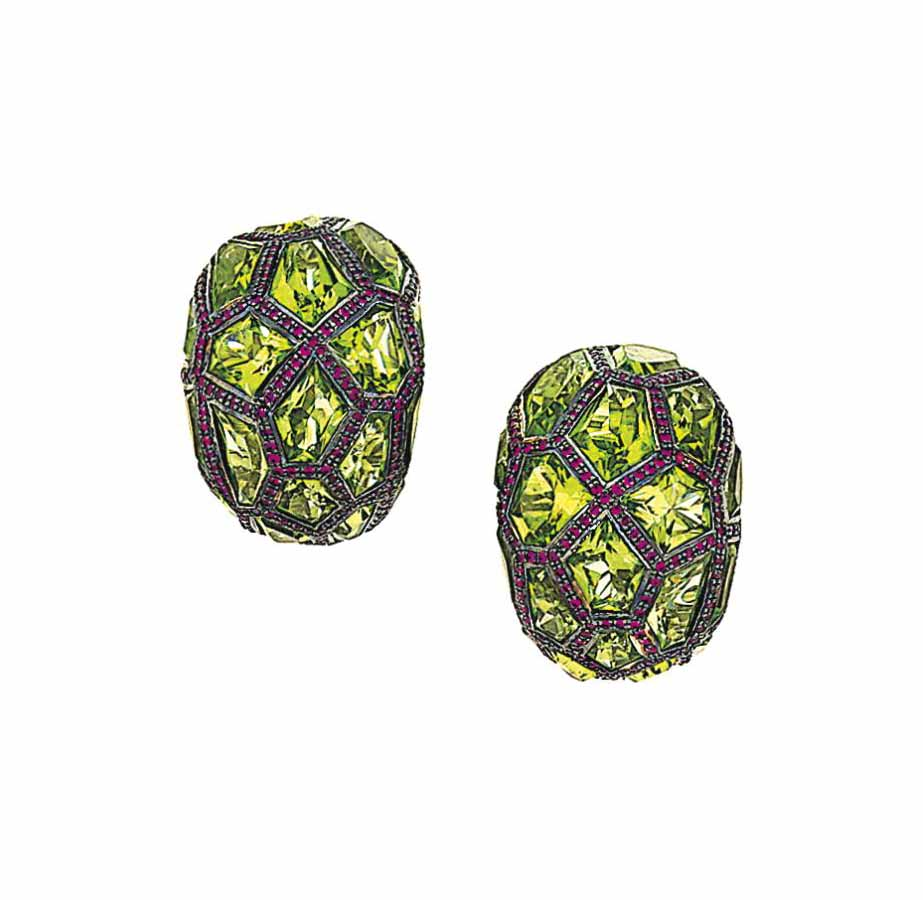 A pair of peridot and ruby ear