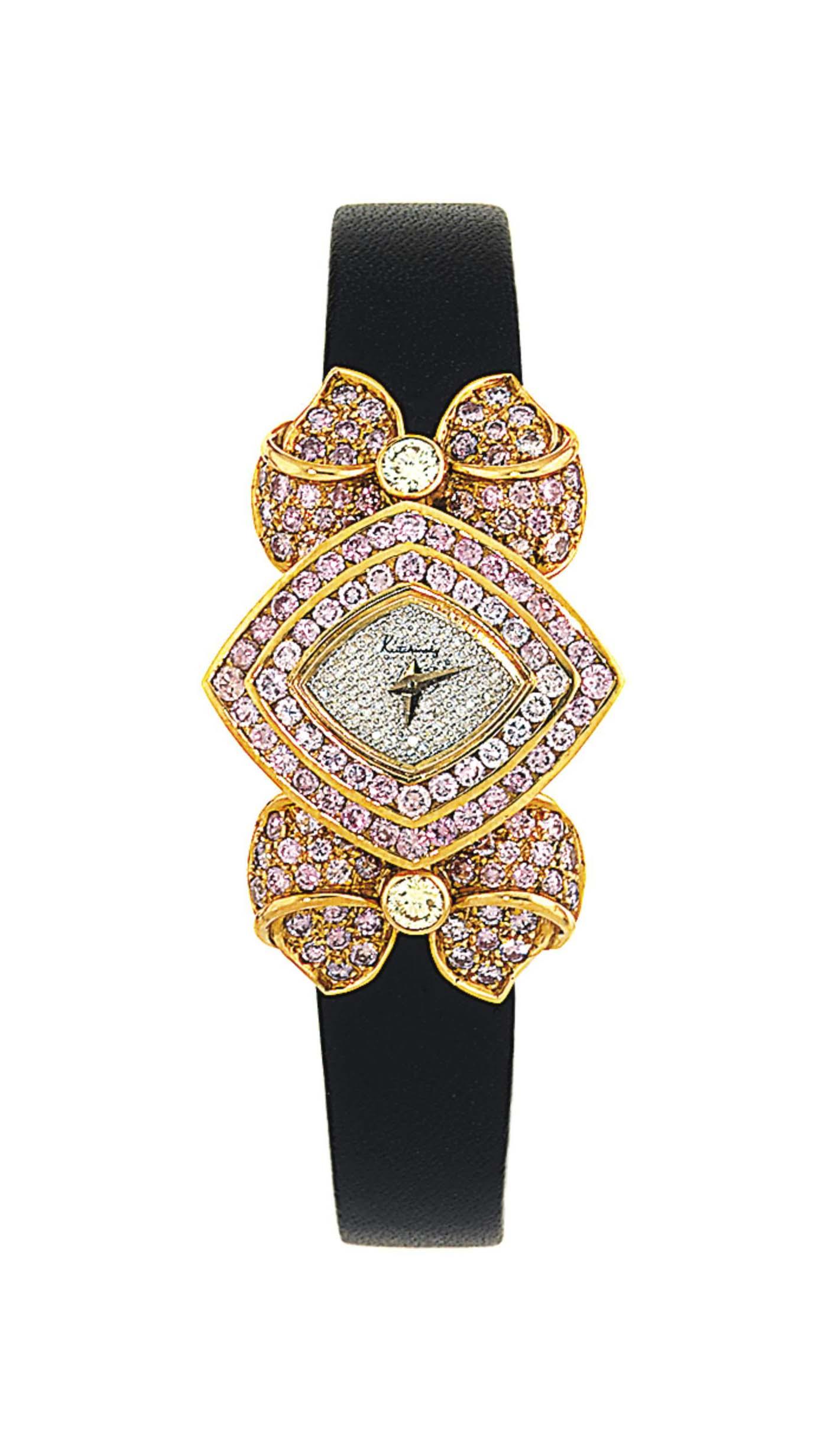 An 18ct gold diamond and coloured diamond quartz wristwatch, by Kutchinsky