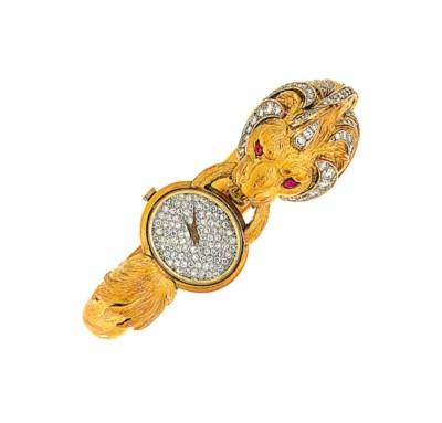 A diamond and ruby wristwatch
