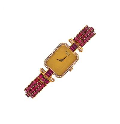 A ruby and diamond wristwatch,